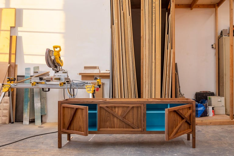 In stock The Inside-Out collection is composed of three pieces: Lungo, Largo, and Corto. This listing is for a walnut Largo sideboard cabinet, buffet, measures: Credenza six feet wide, 13 inches deep, and 2 feet tall. The same piece is also