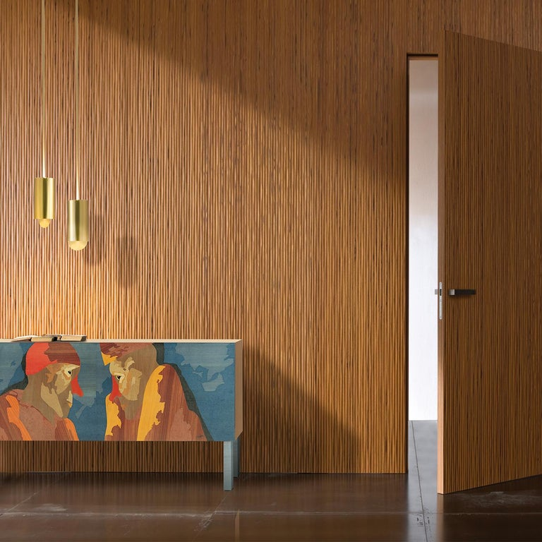 A dream-like composition designed by eminent Milanese poet and artist Emilio Tadini transforms this sideboard into veritable art. The cabinet features a multi-ply poplar wood structure covered in natural maple wood veneer. When open the sideboard