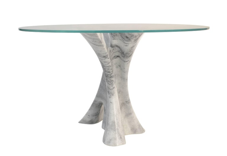 American Interface carved solid marble block dining table with glass top. For Sale