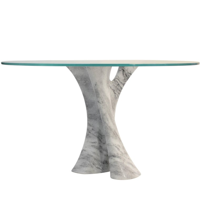 Interface carved solid marble block dining table with glass top. For Sale