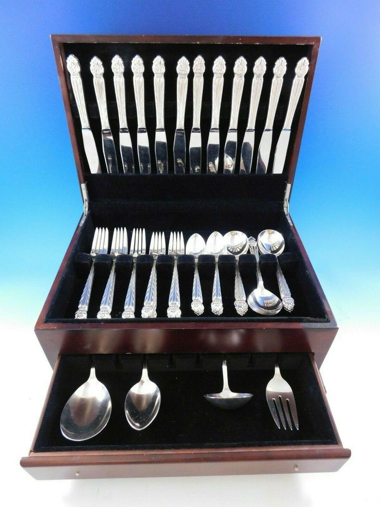 Intermezzo by National sterling silver flatware set with Scandinavian-style design, 65 pieces. This set includes:  12 dinner size knives, 9 5/8