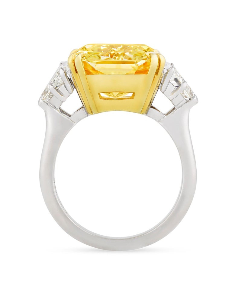 A dazzling 10.67-carat fancy yellow diamond is set in this impressive ring. The rare gemstone is certified by the Gemological Institute of America (GIA) as being an entirely untreated