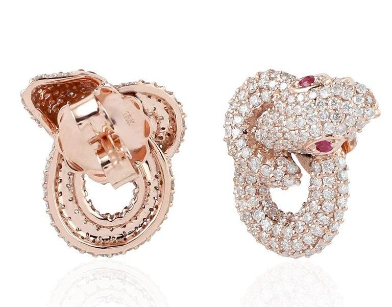 Contemporary Intertwined Snake 18 Karat Ruby Diamond Stud Earrings For Sale