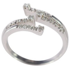 Intini Jewels 0.25 Carat Diamond Brilliant 18 Karat Gold Bypass Spiral Ring