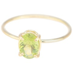 Intini Jewels 0.65 Carat Peridot 18 Karat Yellow Gold Cocktail Chic Oval Ring