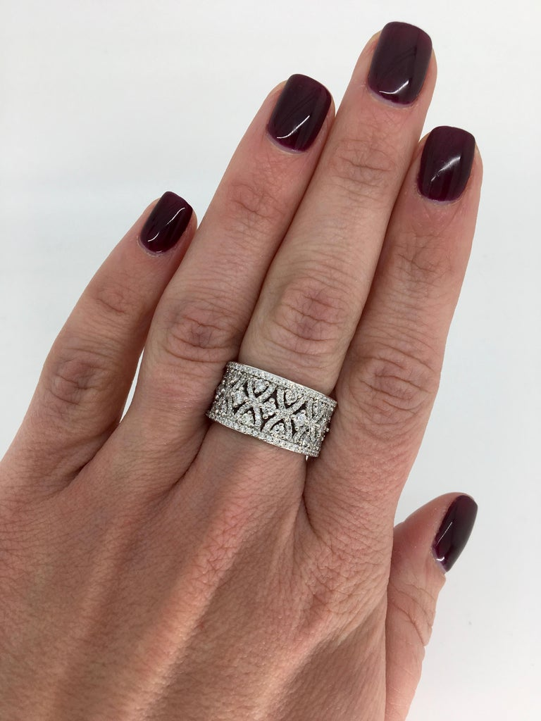 """This 14k white gold ring is adorned with approximately 1.50CTW of Round Brilliant Cut Diamonds set in an intricate """"X"""" shaped design.  Diamond Carat Weight: Approximately 1.50CTW Diamond Cut: Round Brilliant Cut Diamonds Color: Average G-I Clarity:"""
