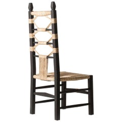 """Intricately Carved and Handwoven Fireside """"Nannai Chair"""" by Chiara Andreatti"""