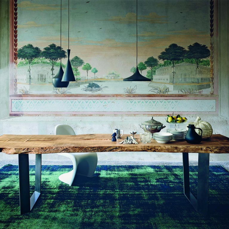 This beautiful dining table boasts a secular olive wood top. Unfinished edges with burnt detailing bring out its natural warmth, beauty and imperfections, telling the story of the tree from which it is made. Handcrafted using dovetail joints, the