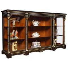 Inverted Breakfront Ebonized Bone Inlaid and Gilt Metal Mounted Cabinet