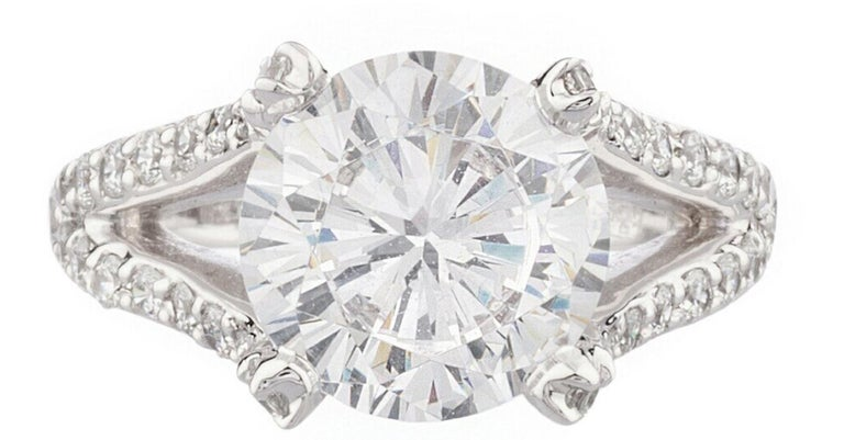 This exquisite GIA 3.50 Carat Round Brilliant Cut Diamond has a beautiful open shank pave of natural brilliant cut diamonds with a total weight of 0.50 carats