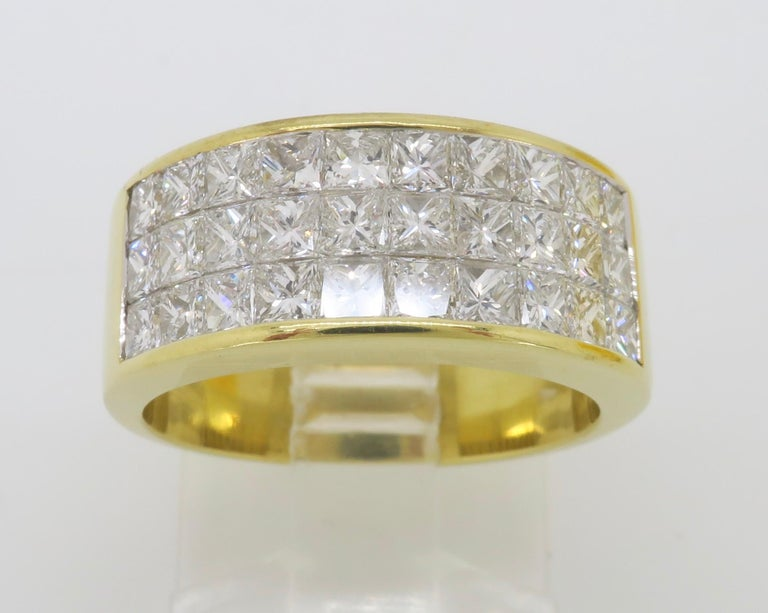Stunning 3.05ctw invisible set princess cut diamond ring made in 18k yellow gold.   Diamond Carat Weight: Approximately 3.05CTW Diamond Cut: Princess Cut Diamonds Color: Average F-H Clarity: Average VS-SI Metal: 18K Yellow Gold Marked/Tested: