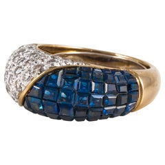 Invisible Set Sapphire Ring with Diamonds in Yellow Gold