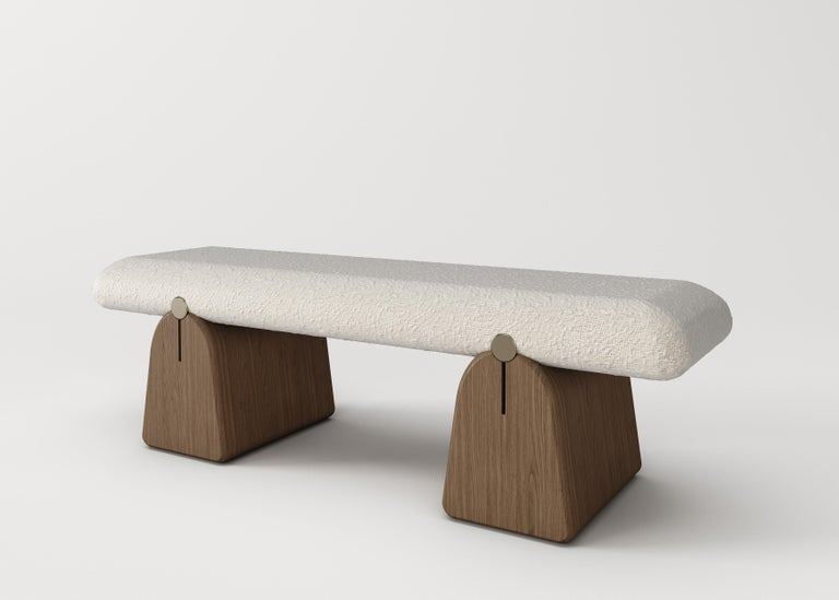 IO bench Signed by Buket Hos¸can Bazman Dimensions: 140 x 42 x 42 cm Material: Patinated brass detailed, solid wood legs, bouclé fabric pouf  Available in custom sizing and finishes Patina application varies in each piece.  Buket Hoscan