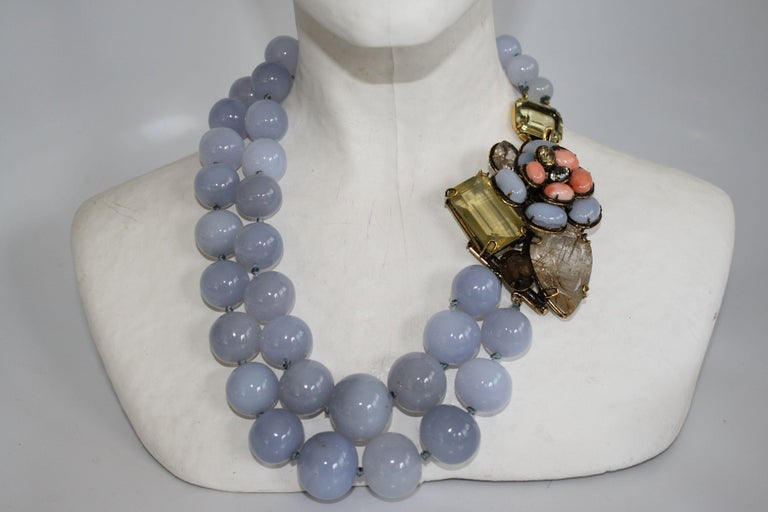Calcedony, coral, citrine, quartz, and topaz necklace from Iradj Moini. Floral closure is also a pin that can be removed and worn separately.   Pin is 3