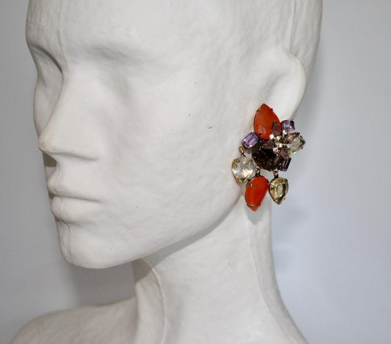 Handmade extraordinary clip earrings from Iradj Moini. Comprised of carnelian, amethyst, and smoky quartz.