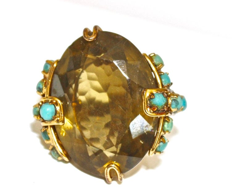 Citrine center stone ring with turquoise detailing from Iradj Moini. Ring is size adjustable and fits fingers sized from 6-8.