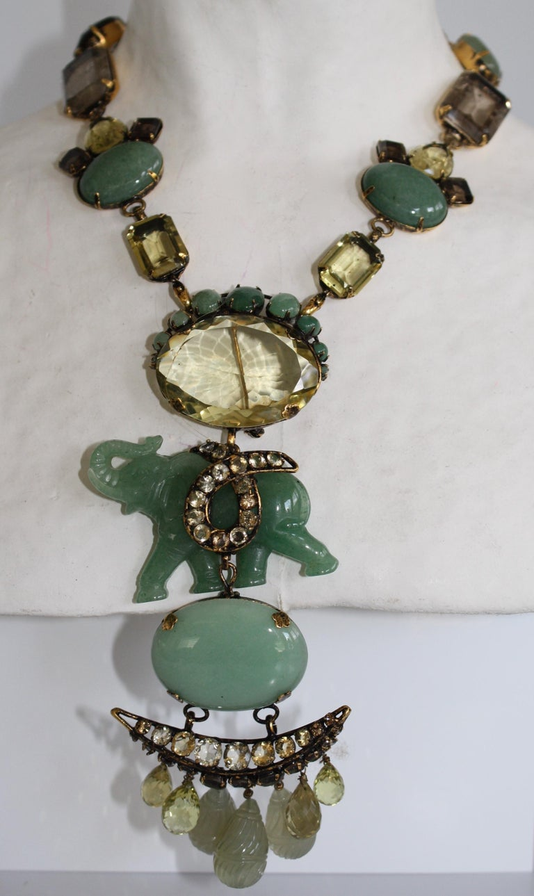 Jade, jasper, smoky quartz and lemon quartz elephant motif necklace from Iradj Moini. Elephant motif is also a brooch that can be removed and worn separately. Brooch is 6
