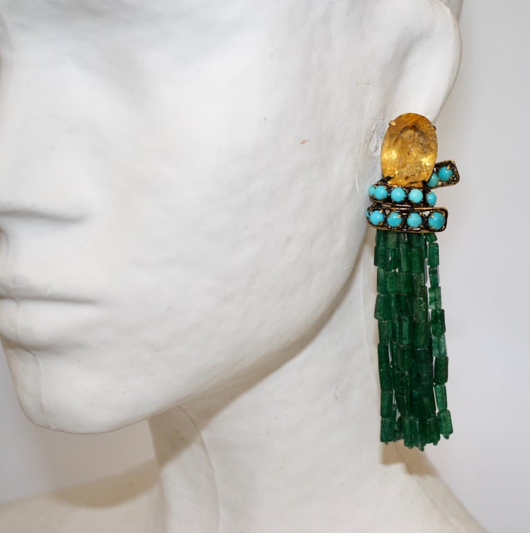 Gorgeous tassel clip earrings from Iradj Moini made with strands of aventurine and a lemon quartz and turquoise clip top.