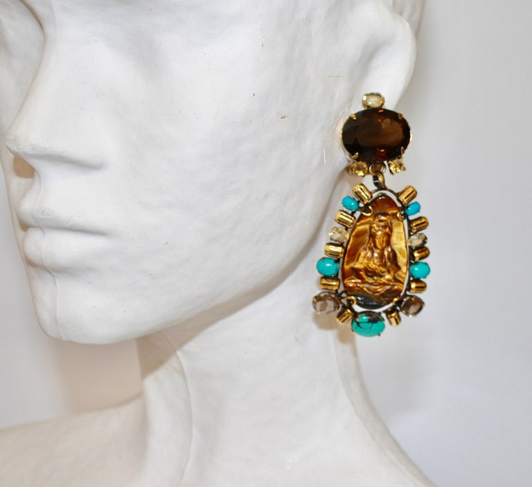 Turquoise, tigers eye, smoky quartz, and lemon quartz clip earrings with carved Buddha motif from Iradj Moini.
