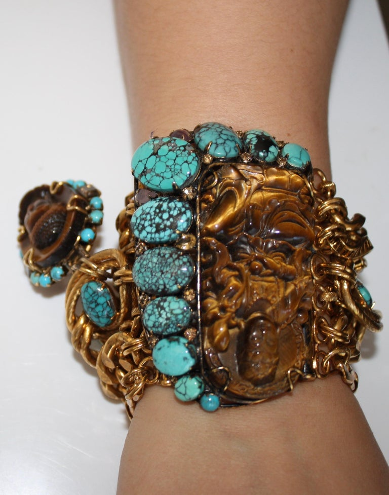 Multi chain statement bracelet with Buddha motif made with tiger's eye, turquoise, amethyst, and gilded brass. One of Iradj's more stunning pieces and made in 2015.
