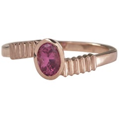 18 Karat Rose Gold with 0.50 Carat Pink Sapphire in Oval Cut Ring