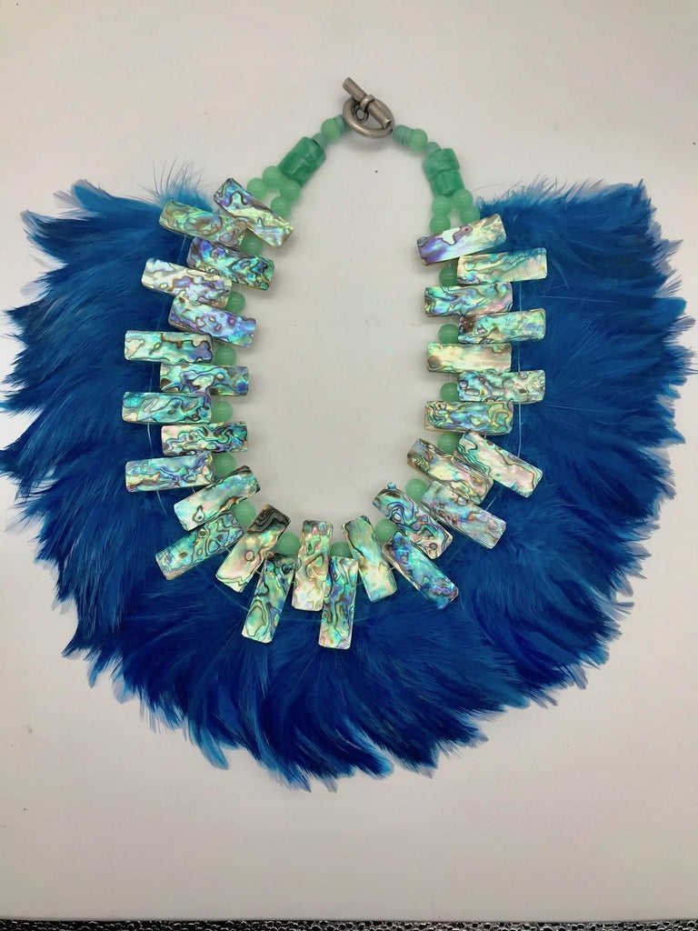 Paua /Abalone ,theatrical Statement Necklace was created for a theater in WDC. I was also worn at the Fashion Show in Sri Lanka during a Literary/Art Fest in Galle.This creation comprises beautifully iridescent Paua beads and royal blue