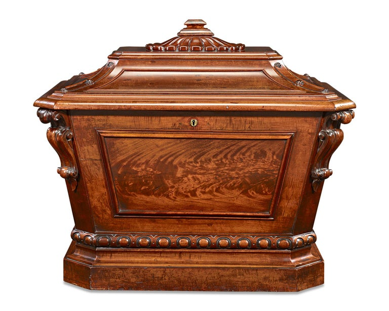 This rare William IV-era Irish sarcophagus wine cellarette, or cooler, is crafted of rich mahogany. Exhibiting beautifully carved details, this cellarette is a marvel of Neoclassical artistry. As practical as it is beautiful, the cooler features 18