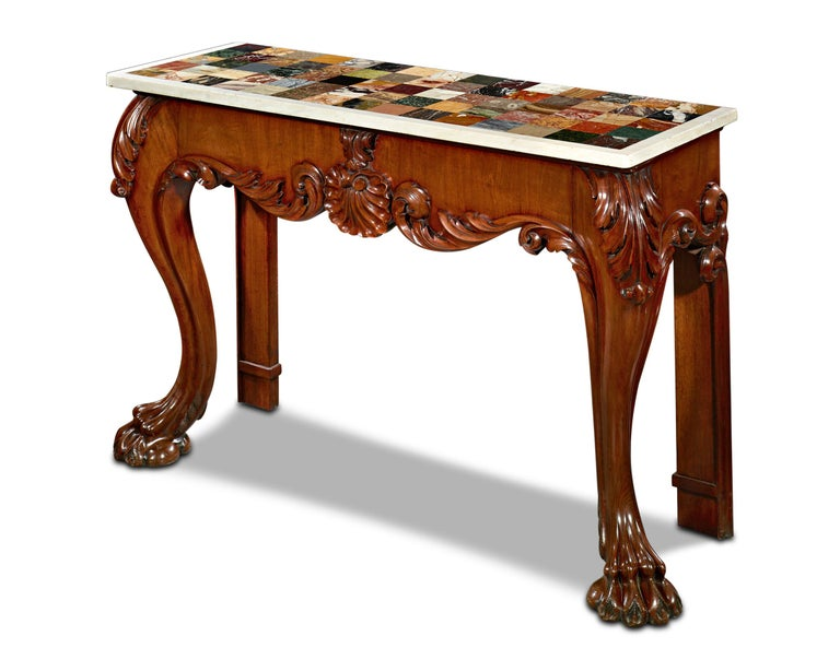 In a prime illustration of the Regency era's appreciation for exotic colors and materials, the surface of this museum-quality Irish specimen console table is inset with 75 of the world's rarest and most important marbles and prized stones, many of
