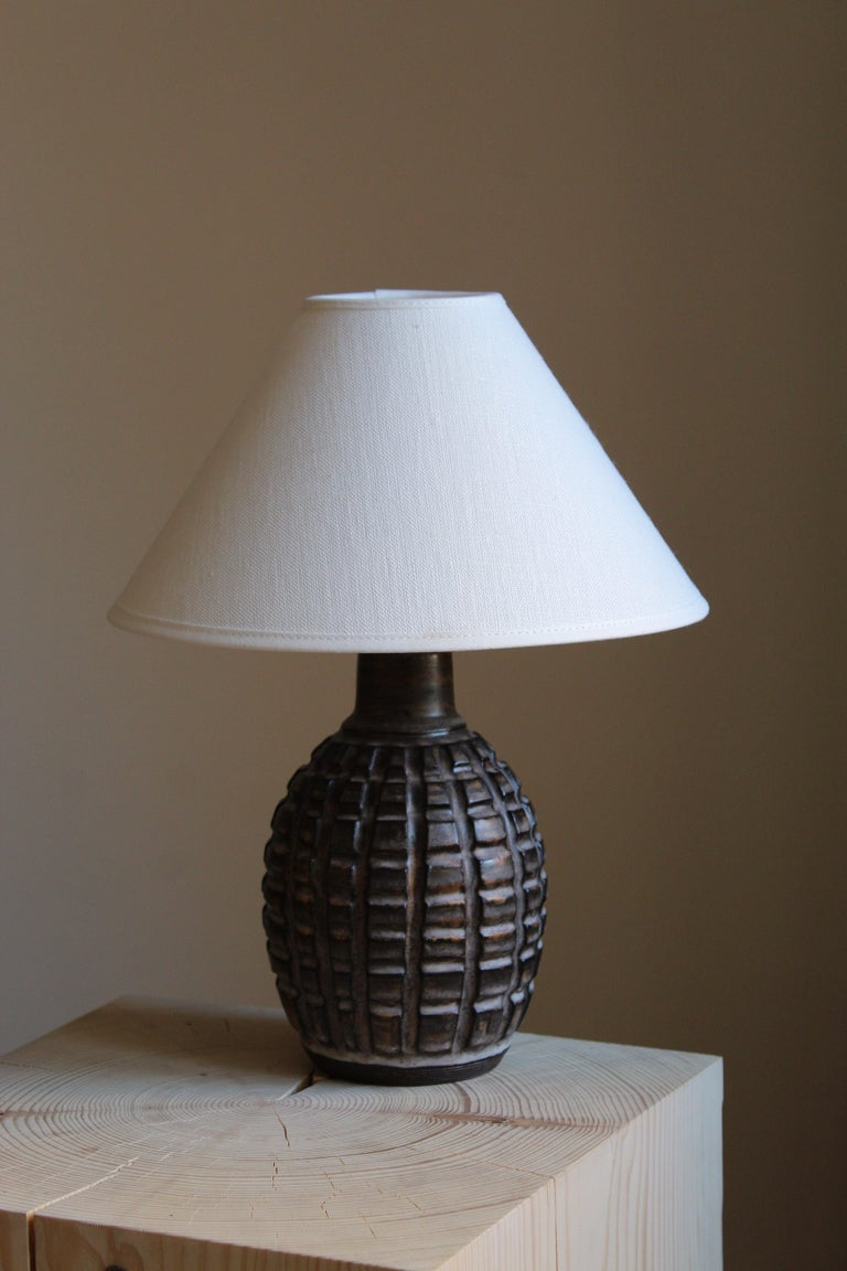 A table lamp by ceramic artist and designer Irma Youstone. Designed and produced in artists' own studio. Sweden, c. 1960s.
