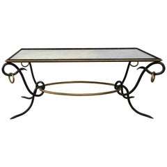 Iron and Bronze Cocktail Table with mirrored top, by René Drouet