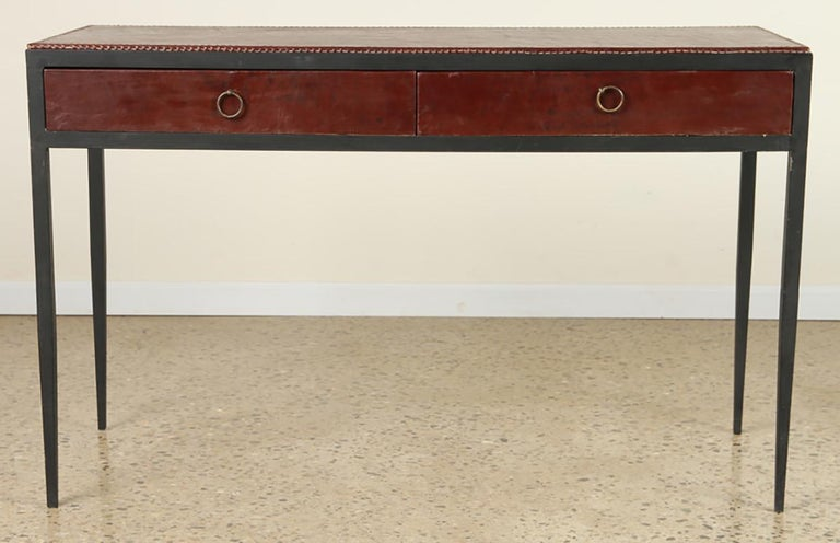 Iron and leather desk/ console on tapered legs in the Jean Michel Frank manner.