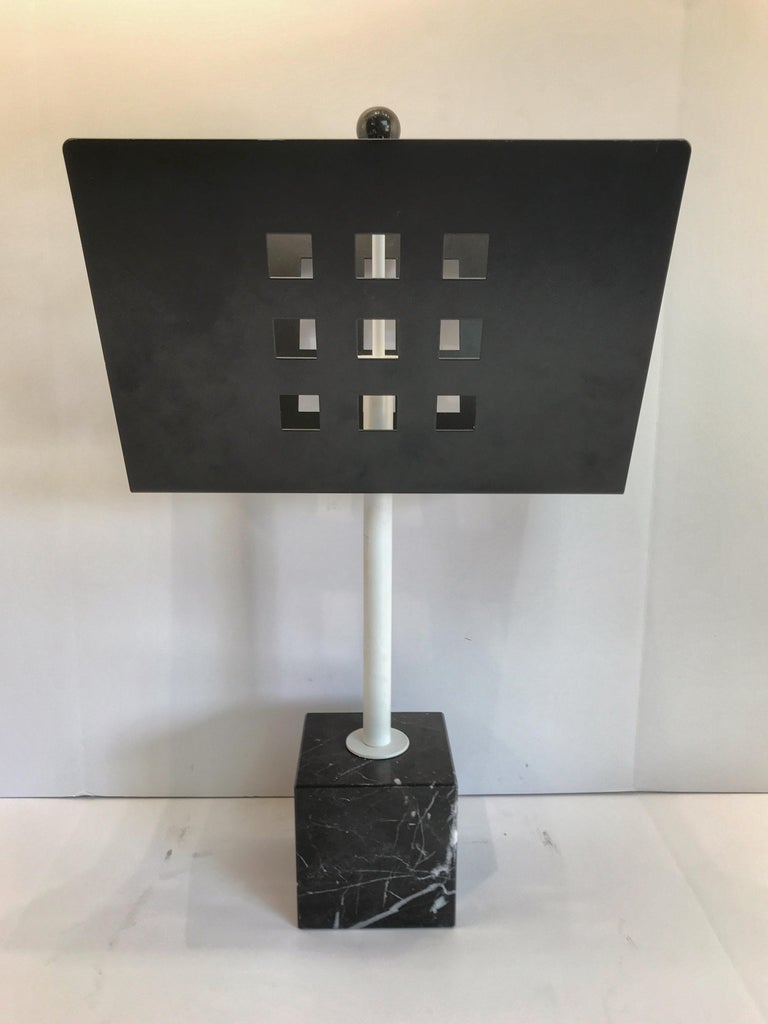 Iron and marble magazine rack, in the manner of Josef Hoffmann, raised on a 5.5