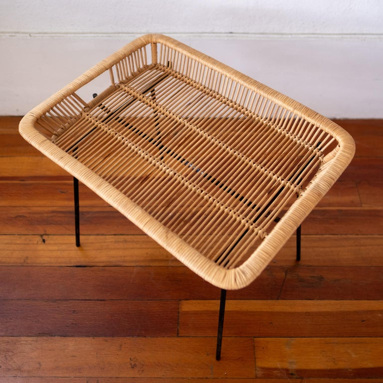 Iron and rattan catch all or tray table from the 1950s. Original finish to the iron base. The tray is in perfect condition.