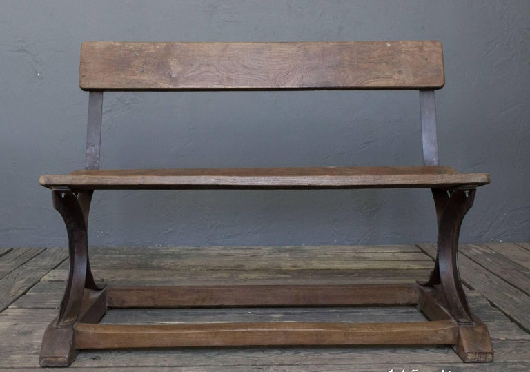 Very unique and small scale bench with a beautiful aged patina. May have originally been used in a factory in India. Four of these benches are available, pricing for all 4 is available. 