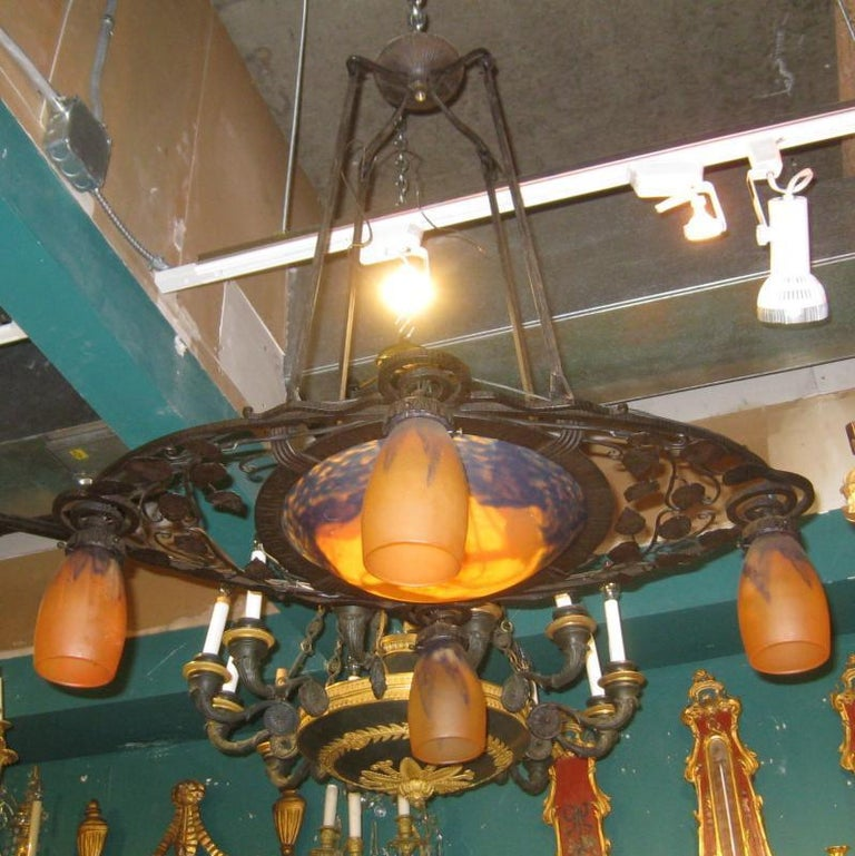 Iron Art Deco chandelier with daum glass shades.