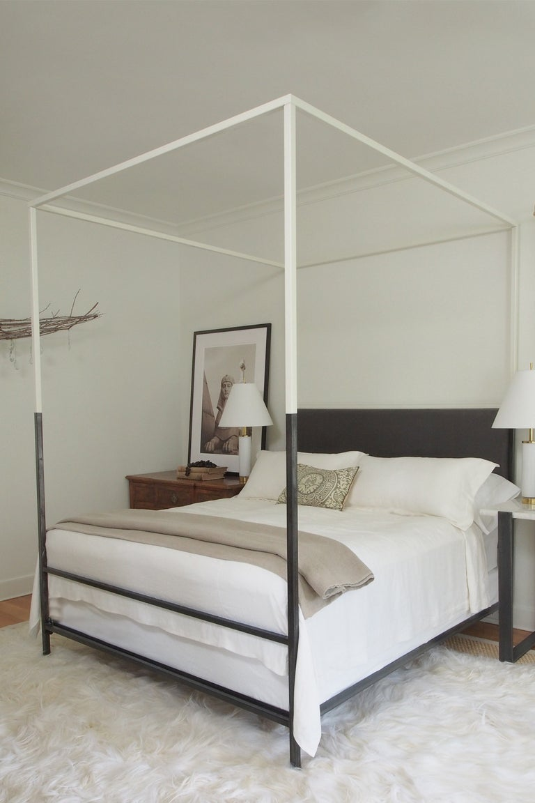 Twin size. This ultra-sleek and streamlined two-tone iron canopy bed with upholstered headboard from the custom Tara Shaw Maison collection has been featured in several shelter magazines, including veranda and architectural digest. Handcrafted in