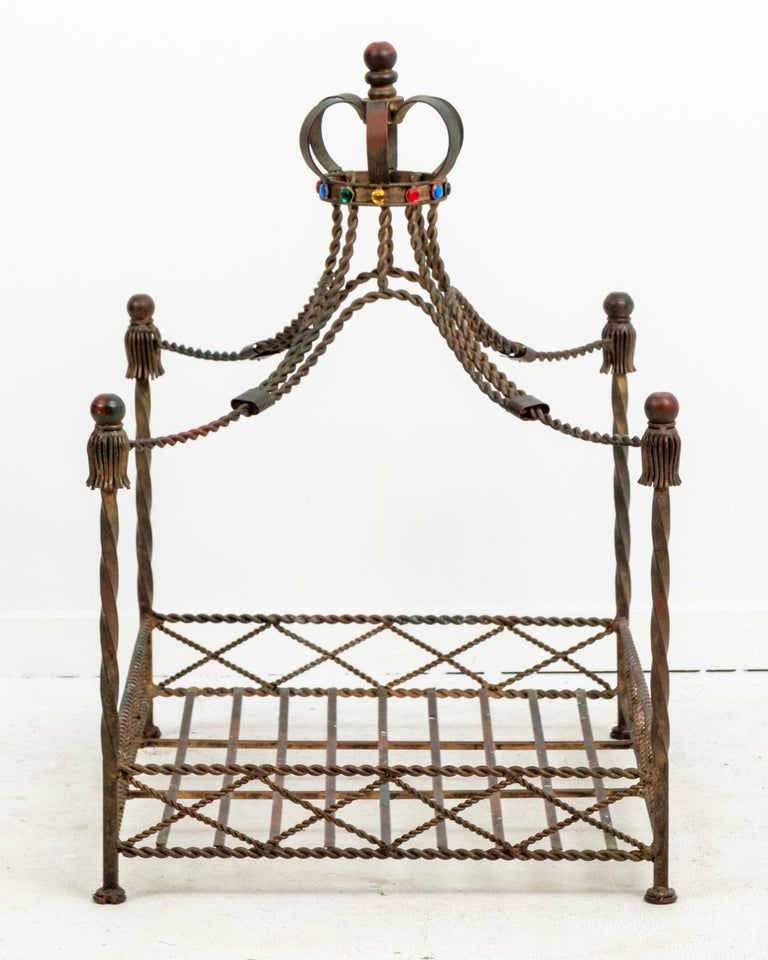 Iron dog bed with jeweled crown on top of the Iron canopy in a worn, gilt finish, circa 1980s. Made in Italy. Please note of wear consistent with age including patina.
