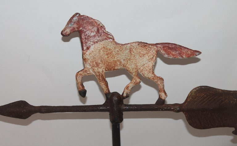 This iron weather vane horse with great paint and patina comes with a tabletop stand. All original paint.