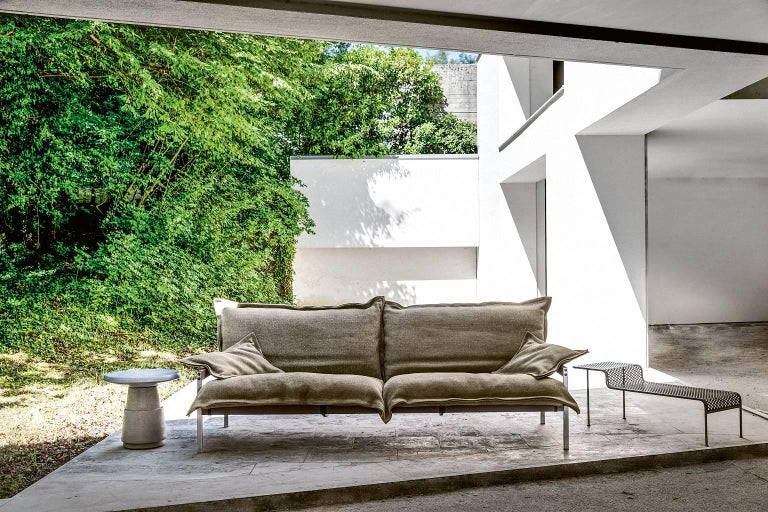 """""""Iron Maiden"""" is a three-seat sofa, designed by Diesel Creative Team and manufactured by Moroso, featuring structure in brushed stainless steel and tighted polyester/PVC net, armrests in varnished steel. Cushions in stress-resistant polyurethane"""