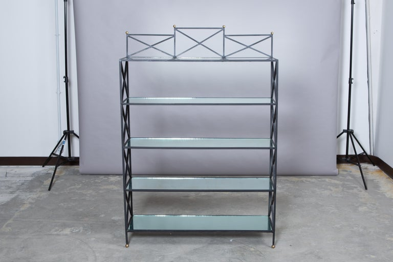 1950s French iron neoclassical style etagere with five mirror shelves, gold ball feet and detail. Light age to mirror. Very good condition for age! Measures: 53