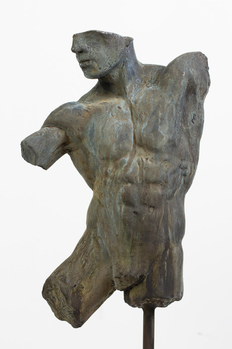 This is an extraordinary bronze sculpture of a Classic male nude fragment by artist Dean Kugler with a verdigris patina.  Attention to detail and complete understanding of the human figure are evident. The sculpture is beautifully custom mounted on
