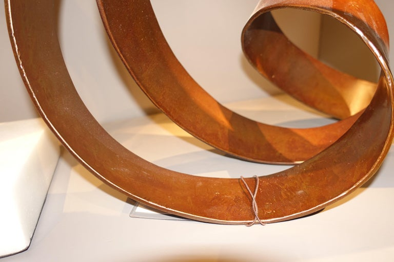 Contemporary Indonesian brown metal with leather look finish shaped as flowing ribbon sculpture Freestanding.