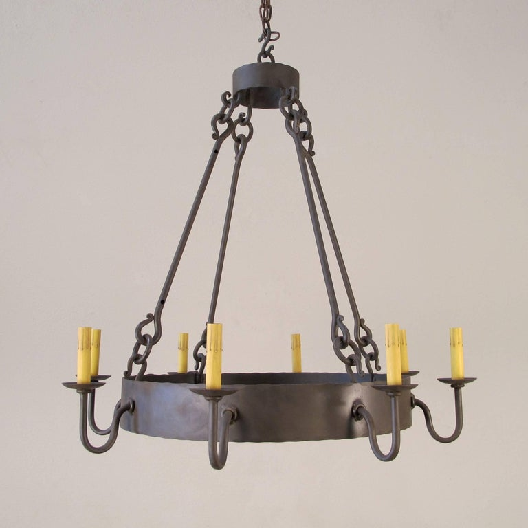 Part of the chandelier product line, this is our Newport Chandelier, Small. Forged iron ring chandelier with 8 candelabra base lights. Made to order. UL Listed and made in California.
