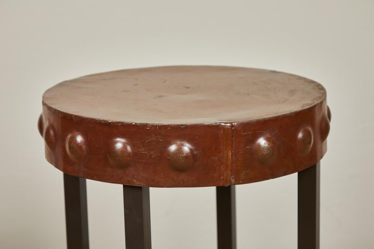Two made to order heavy metal side tables. Painted brown tops and black legs. Priced and sold individually.