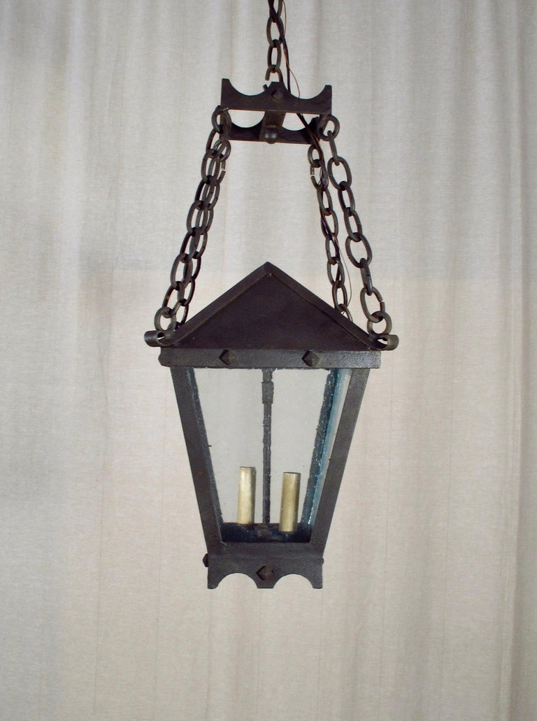 Part of the CHANDELIER Product Line, this is our Scott Lantern, Small. This fixture can be used for Interior or Exterior use and is UL Listed. 3' chain included. Four candelabra base bulbs up to 60 watts/socket. Also available in Large Size. This