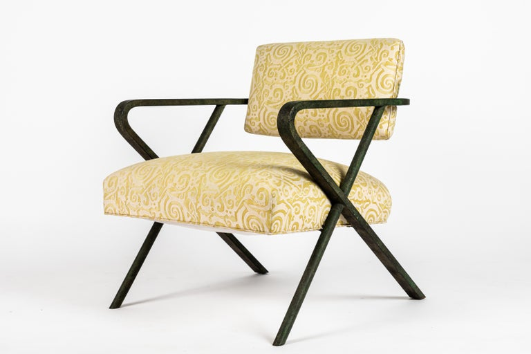 Another rare find, the X chair designed by William Haines. The iron frame has a patinated finish resembling verdigris and is in fine condition. The upholstery on this example has been replaced with Fortuny fabric at some point in the last 15 yrs.