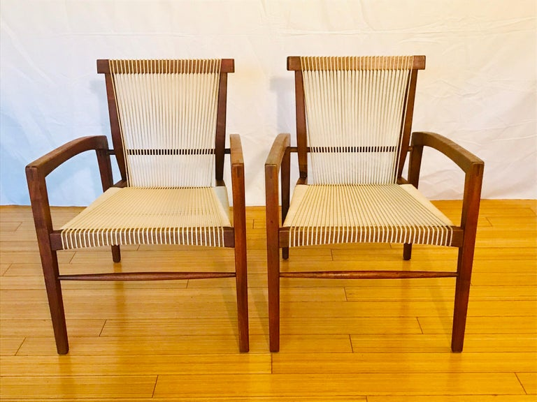 A rare pair of chairs. Only a few of these were made and or have survived. Handcrafted sculpted walnut with cord. Original vintage condition with minor ware and patina. The wood has been cleaned a little without taking away from its' historical