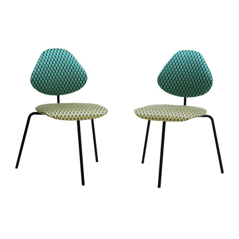 Midcentury pair of Italian chairs designed by ISA Bergamo in Ponte San Pietro, province of Bergamo. Made of black lacquered metal structure, seat and back reupholstered in pattern cotton satin fabric model