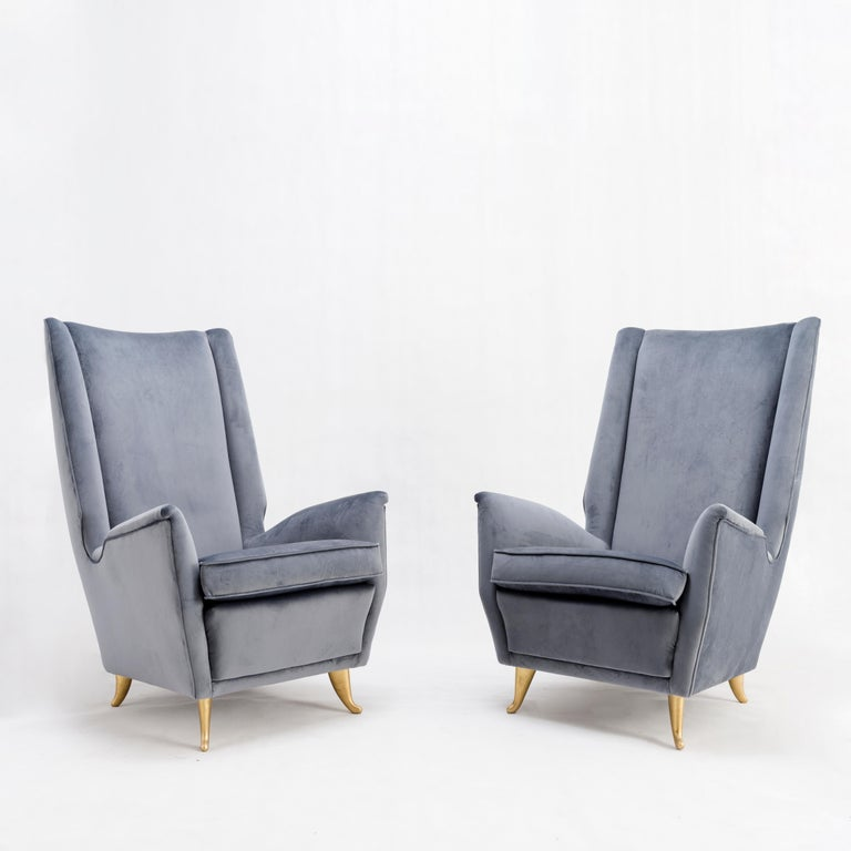 Isa Bergamo Pair of armchairs Gold-painted metal, velvet Italy, circa 1950.  ISA Bergamo was a high quality manufacturer who worked among many others for Gio Ponti.