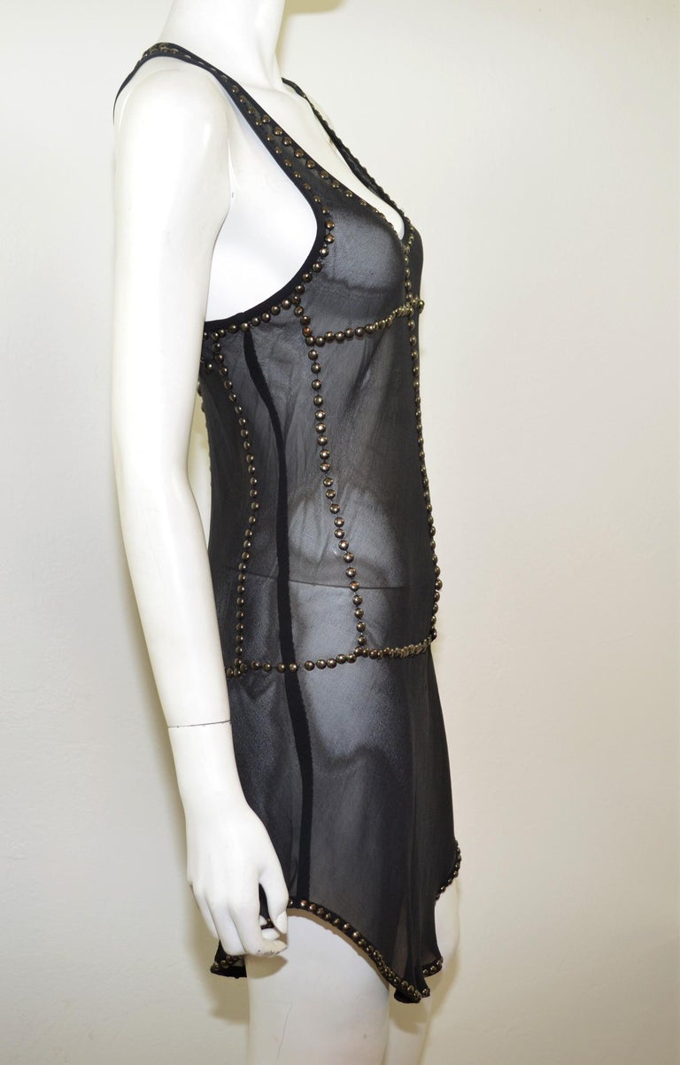 1e4b1f1cdc6 Isabel Marant sheer tunic dress featured in black with silver-tone brass  studs. Dress